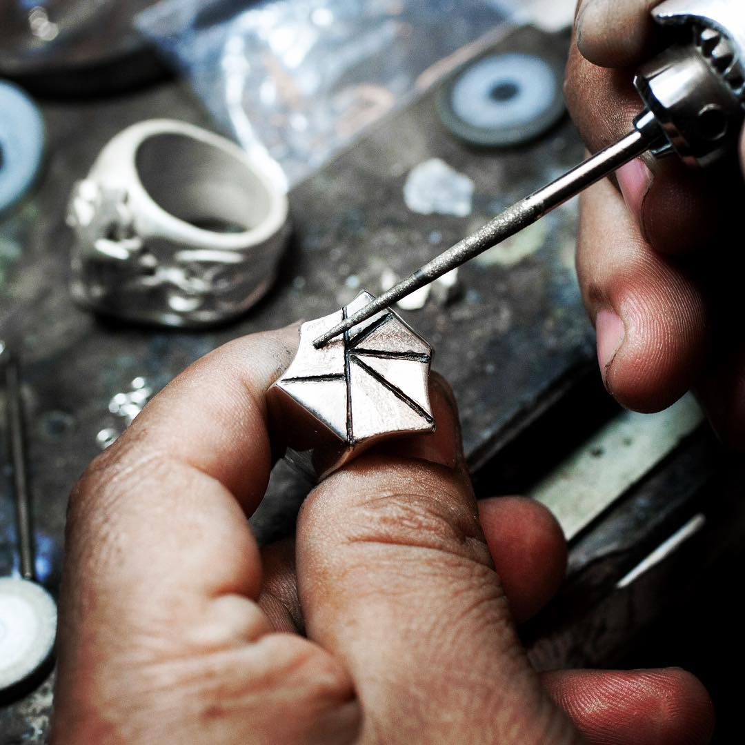 Image of custom silver ring being crafted