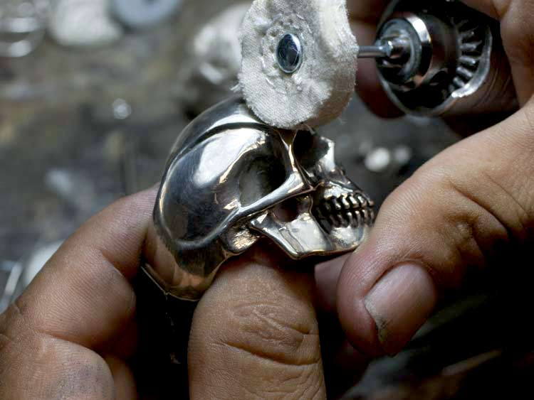 Silver Skull Ring Being Polished