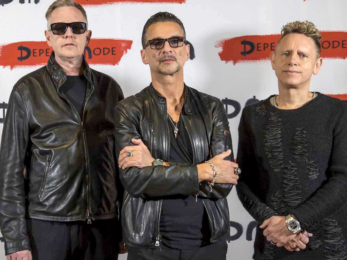 Depeche Mode and Dave Gahan pose with raven skull pendant necklace