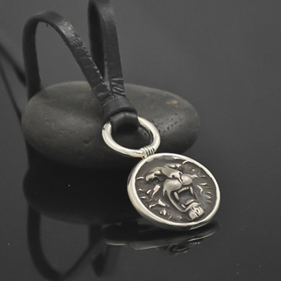 Silver Lion's Head Pendant with Blue Diamonds Strung on Leather